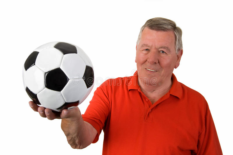 Old man with soccer ball stock images