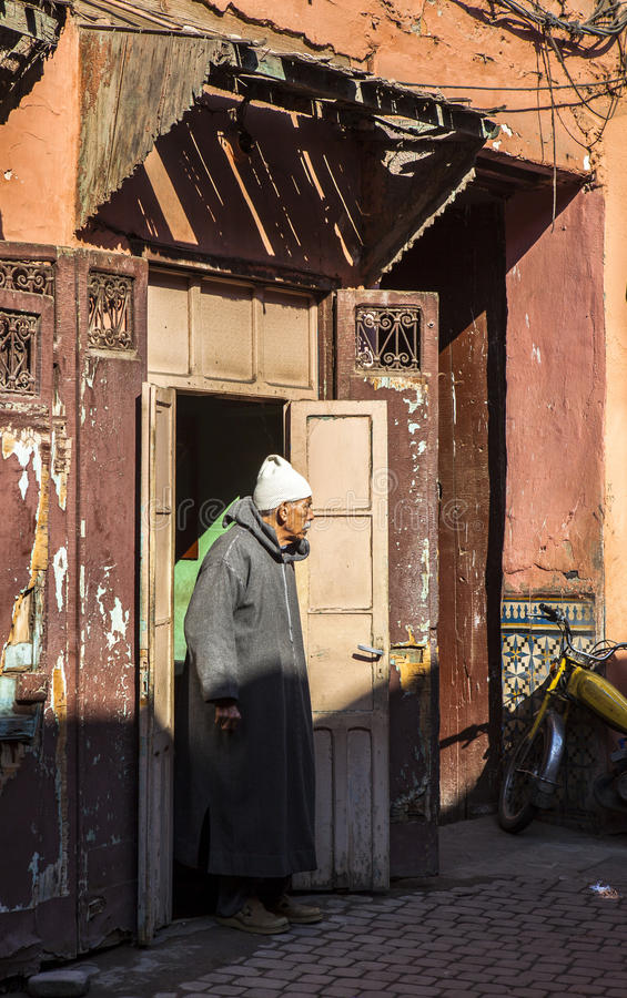 A old man in Souk market of Marrakech, Morocco royalty free stock image
