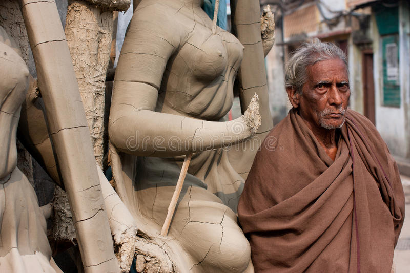 Old man stands near the woman sculpture stock photography