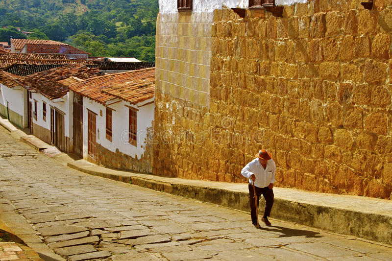 Old man, steep colonial street stock photo