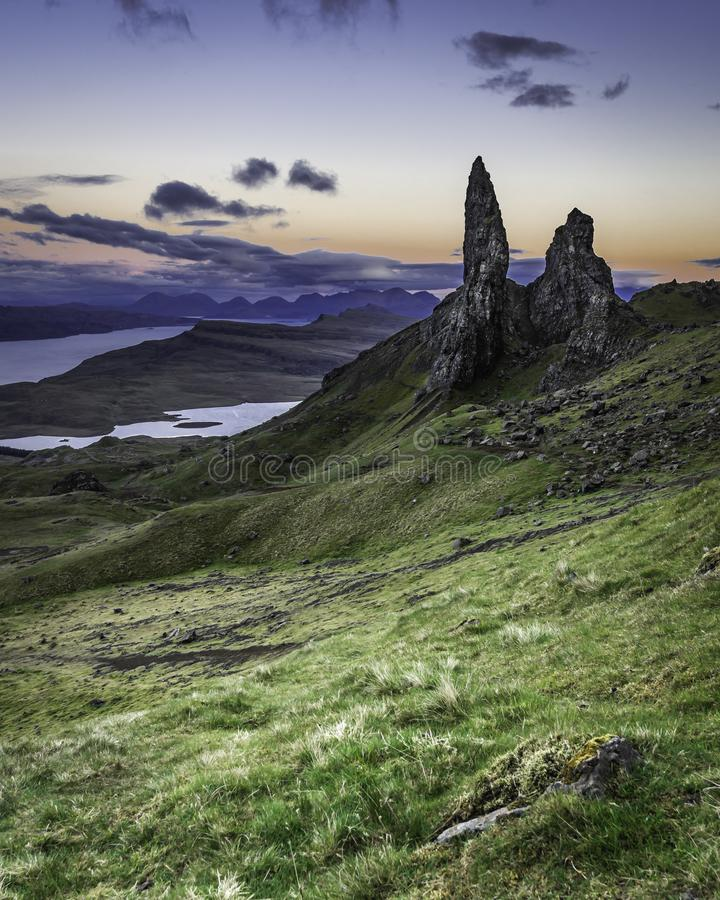 Old man of Storr photographed at twilight.Famous landmark on Isle of Skye, Scotland. Old man of Storr photographed at twilight.Famous rock formation landmark stock image