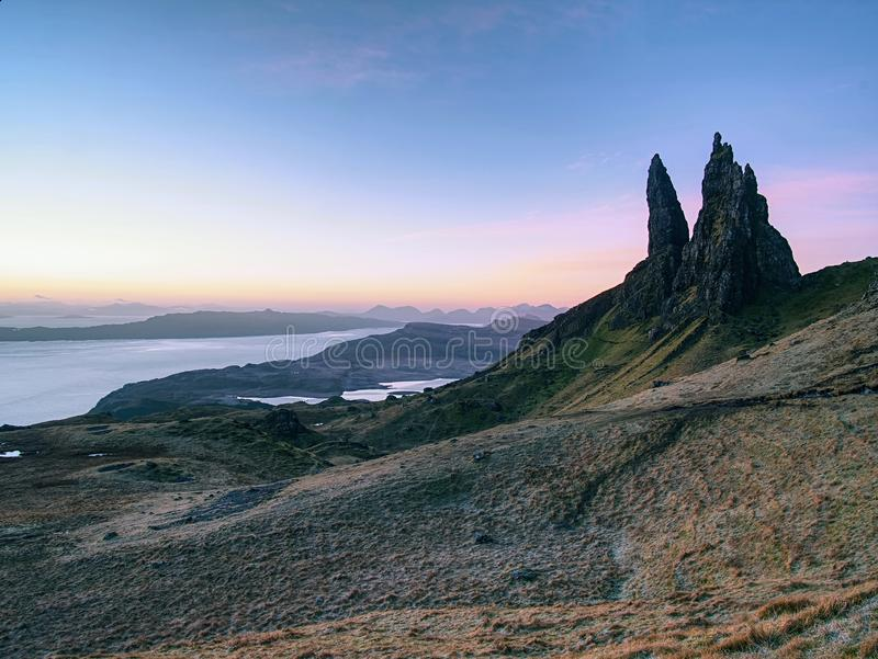 Old Man of Storr rocks with clear sky Isle of Skye Scotland, February morning. Old Man of Storr rocks with clear sky Isle of Skye Scotland, cold February morning royalty free stock image