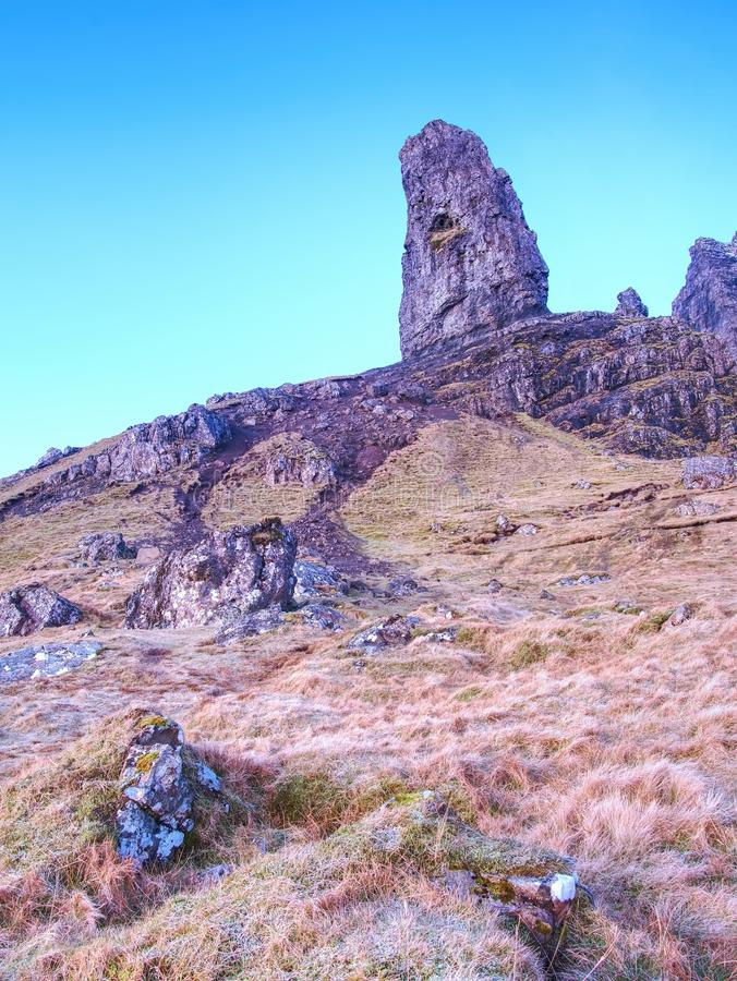 Old Man of Storr rocks with clear sky Isle of Skye Scotland, February morning. Old Man of Storr rocks with clear sky Isle of Skye Scotland, cold February morning royalty free stock photo