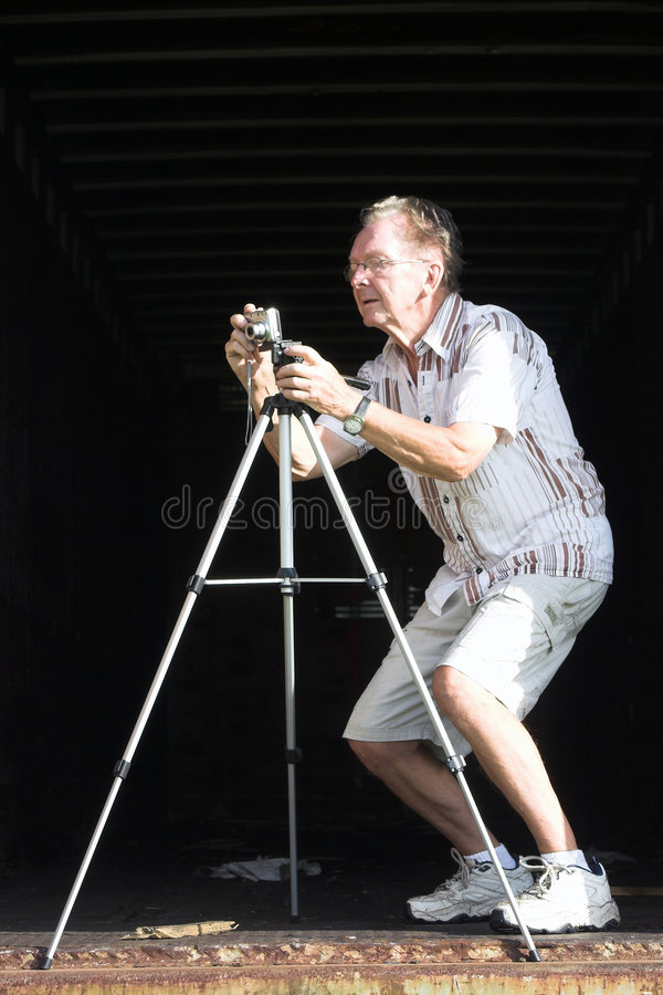 Old man taking a picture stock photo