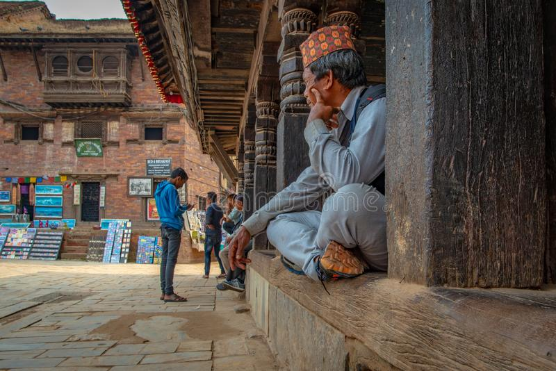 Old man with traditional nepalese hat stock photo