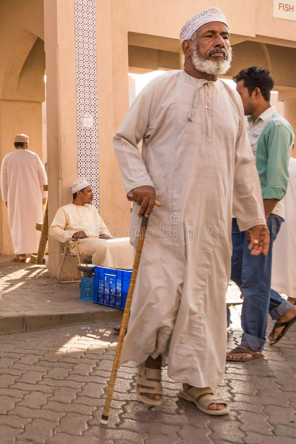 Old man in traditional Omani clothes in the Nizwa souq on Friday stock photography