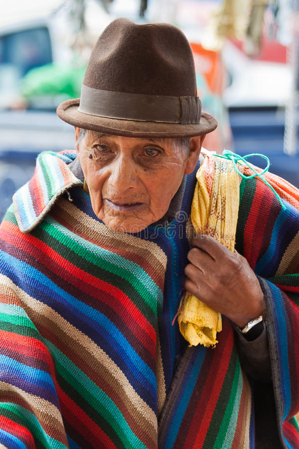 Old man with traditional striped poncho stock photography