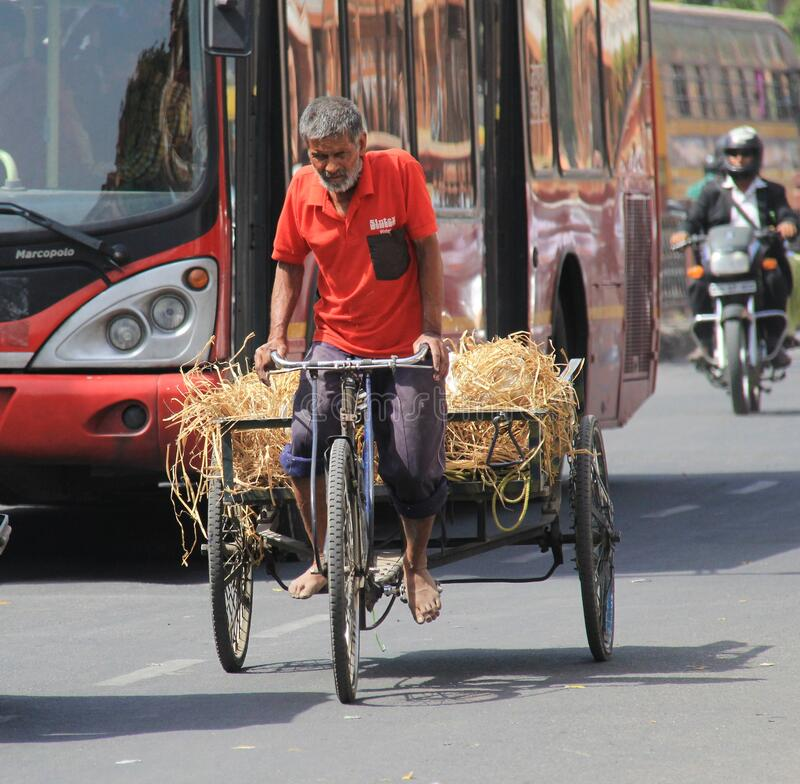 Free Old Man Using Tricycle As A Goods Transport Vehicle Royalty Free Stock Photos - 174842168