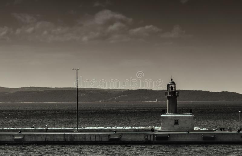 Ligthouse and old man royalty free stock photos