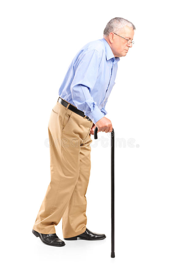 Old man walking with cane. Isolated on white background stock images