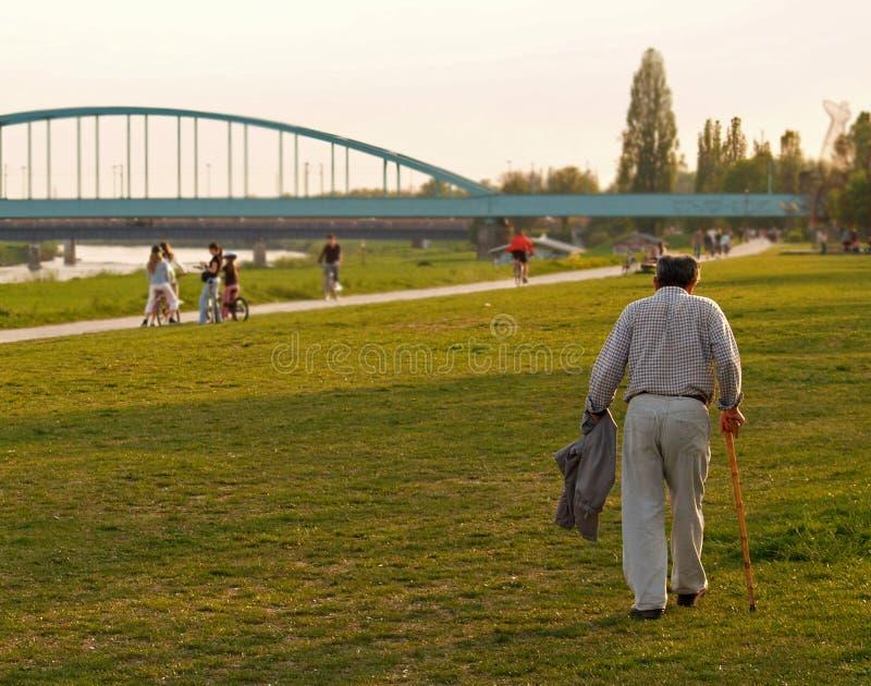 Old Man Walking Down The Promenade royalty free stock photos