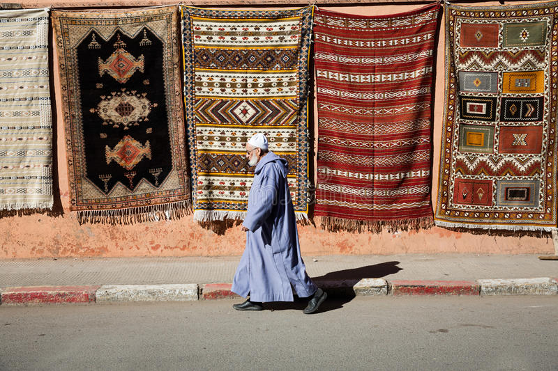 Old man walking in the medina stock images