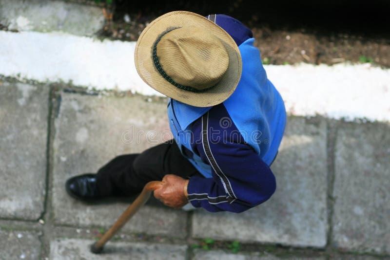 Old man walking on sidewalk stock photos