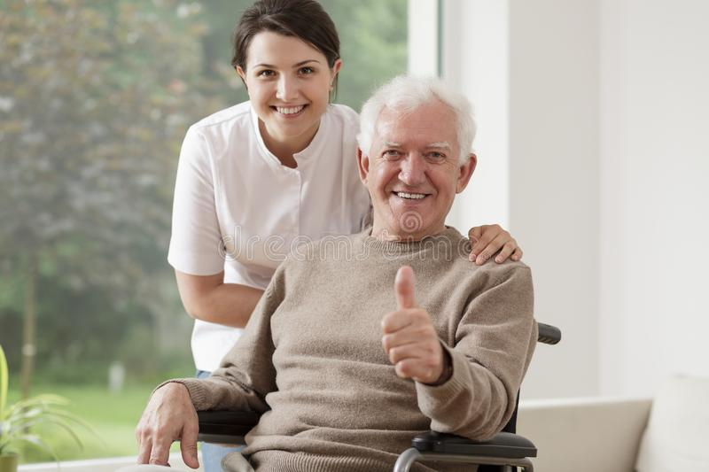 Old man on wheelchair stock photography