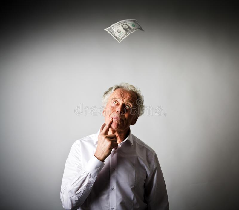 Old man in white and one dollar. royalty free stock photography