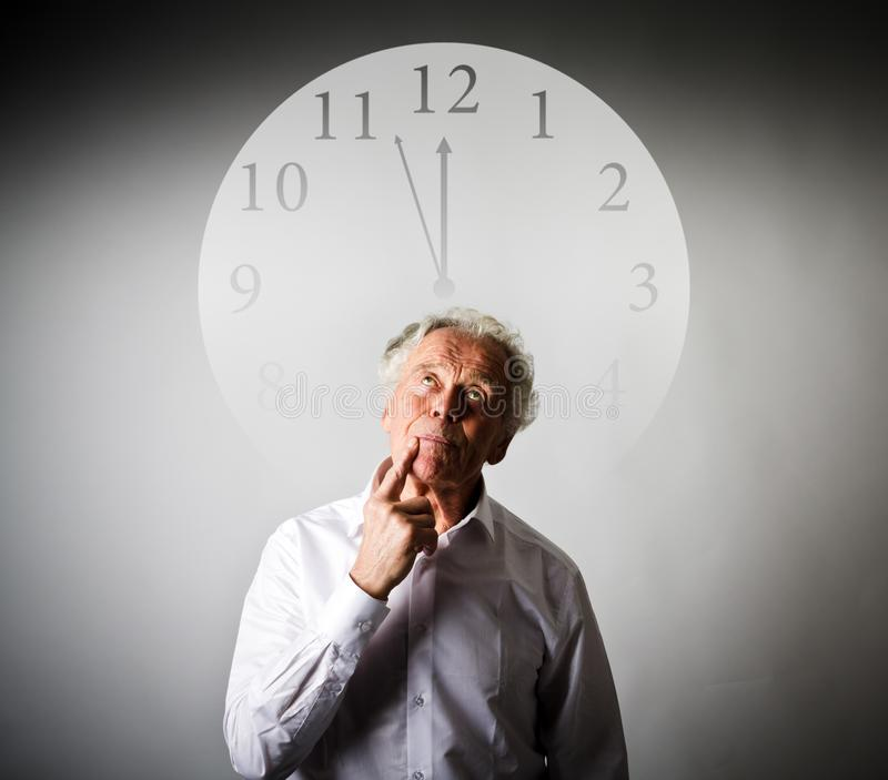 Old man is waiting. Three Minutes to Twelve. royalty free stock images