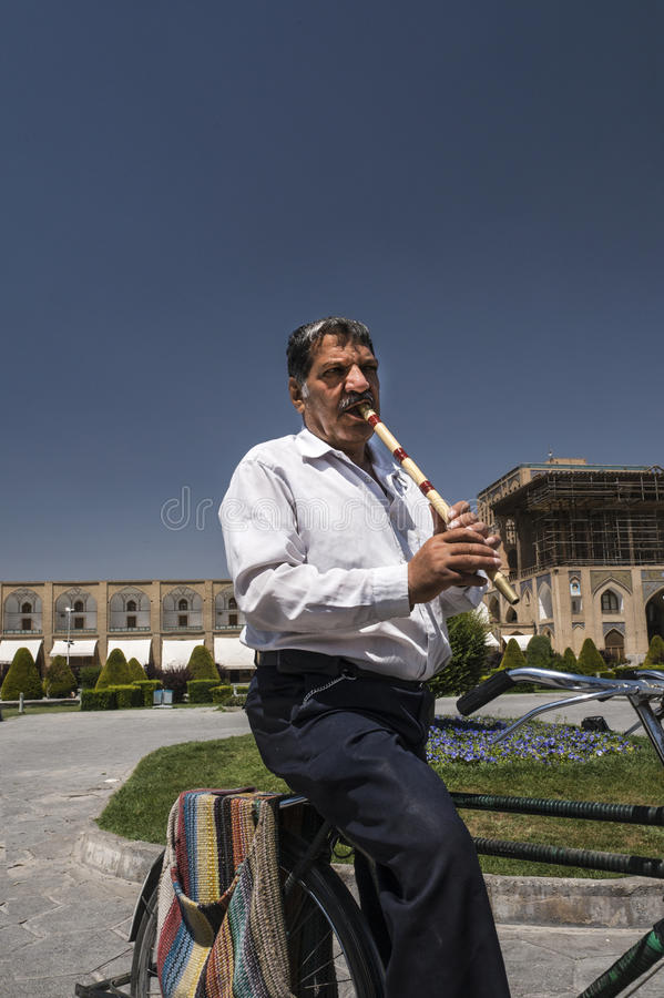 An old man who fluting on Imam Square royalty free stock photography