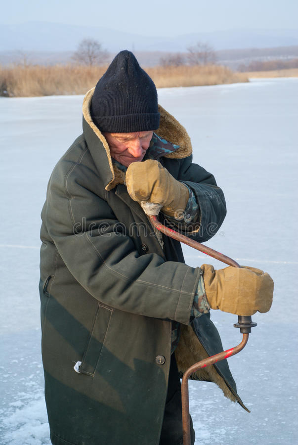 Old Man On Winter Fishing 1 Stock Photo