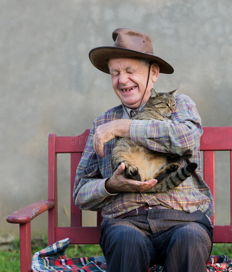 Free Old Man With Cat Royalty Free Stock Photography - 35282977