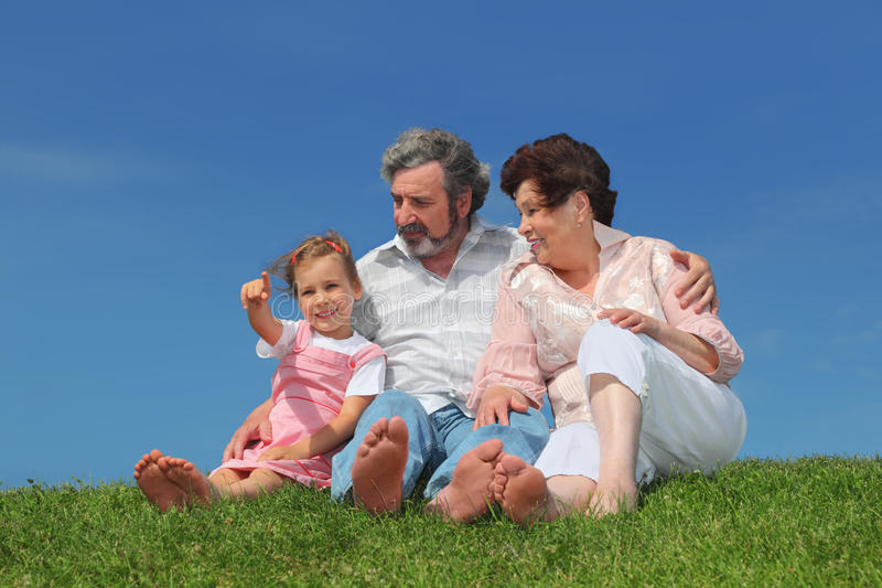 Download Old Man And Woman Sitting With Granddaughter Stock Photo - Image: 20005318