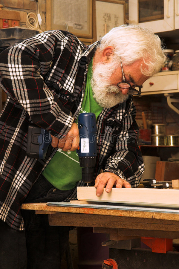 Download Old Man Working Royalty Free Stock Photo - Image: 1354235