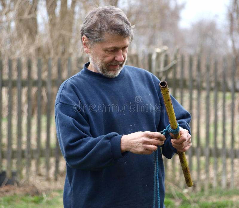 Download Old man working stock photo. Image of mature, concentration - 13818902