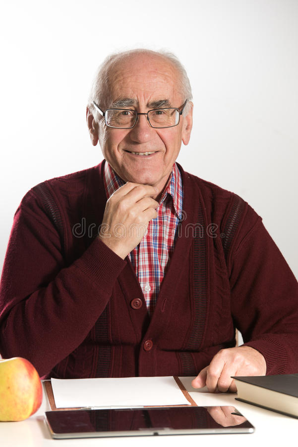 Old man works with documents stock image