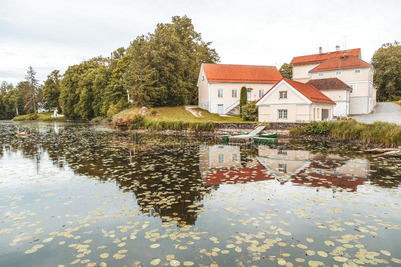 An old manor house Vihula in Estonia, Lahemaa park. Beautiful au. Tumn landscape with pond royalty free stock photo
