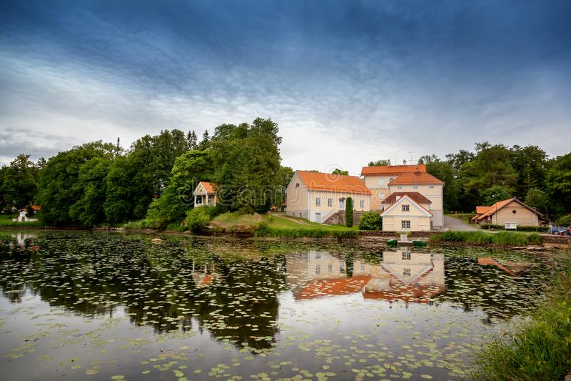 An old manor house Vihula in Estonia, Lahemaa park. Beautiful summer landscape with pond stock image