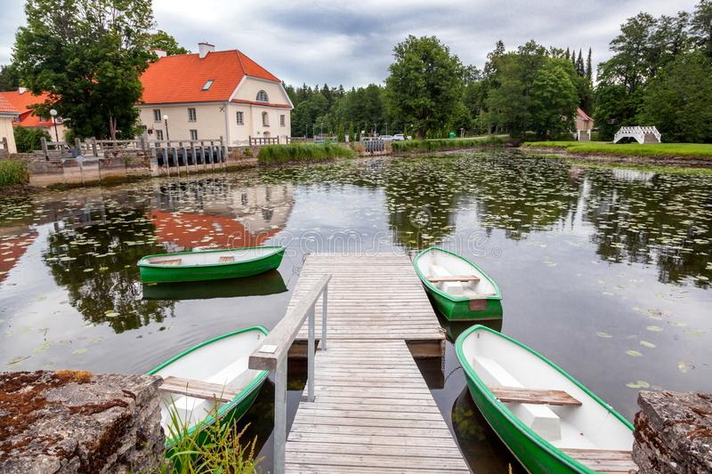 An old manor house Vihula in Estonia, Lahemaa park. Beautiful summer landscape with pond stock photography