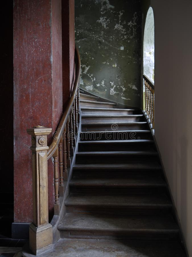Old Mansion With Wooden Stairs And Dark Marble Column 02 stock photo