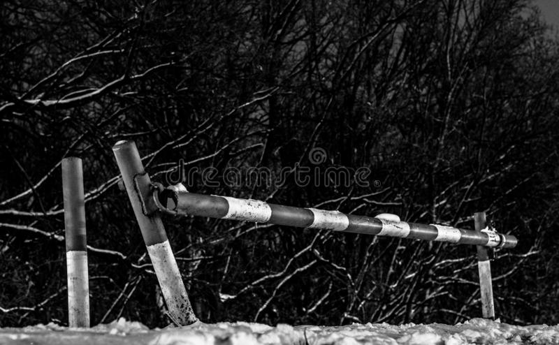 Old manual barrier in black and white stock photography