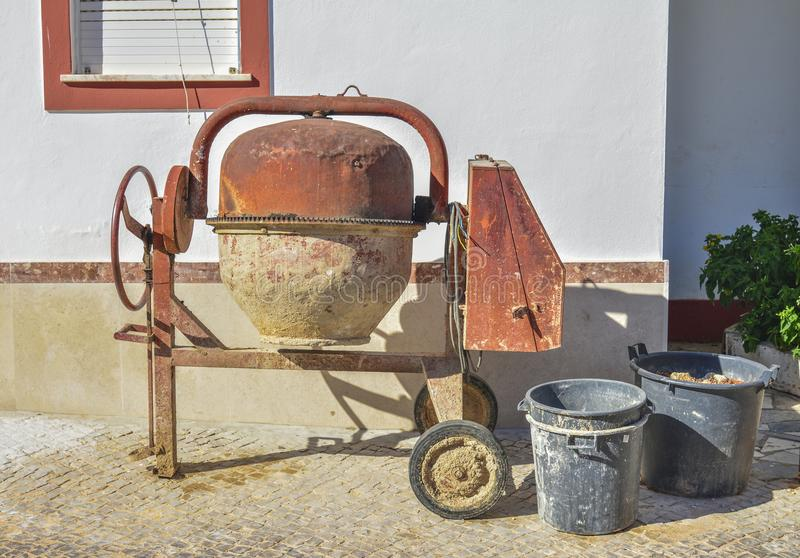 Old manual mixer machine. Old rusty manual mixer machine near the house royalty free stock images