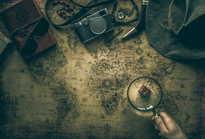Old map and vintage travel equipment / expedition concept, treasure hunt stock images