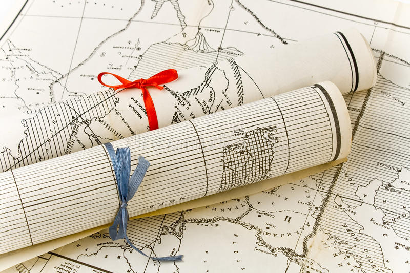 Old Maps in rolls with colorful ribbons. Two Old Maps in rolls with colorful ribbons royalty free stock image