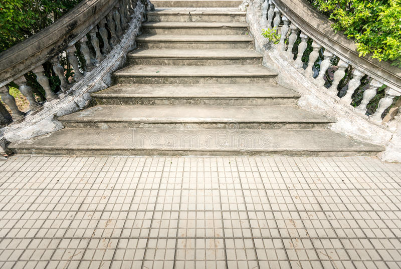 Old grungy stone stairway outdoor in summer. stock images