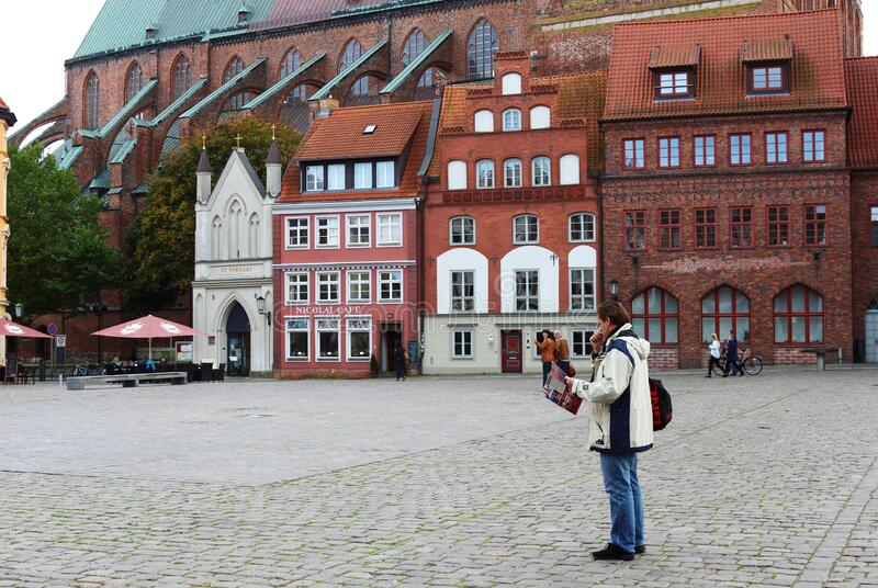 Tourist in Stralsund, Old Market, Germany royalty free stock photo