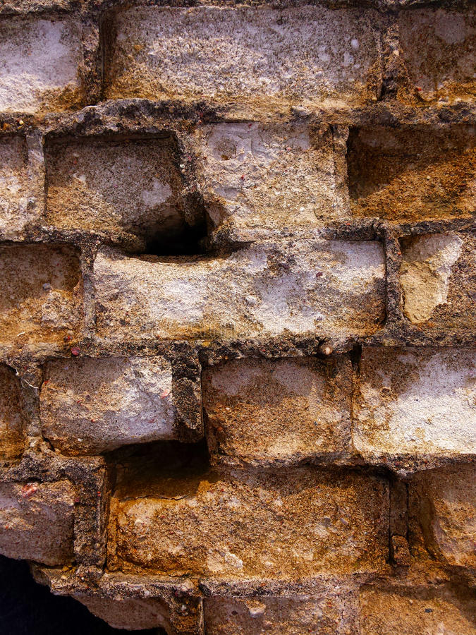 Old masonry with holes. Could be used as a background stock photos