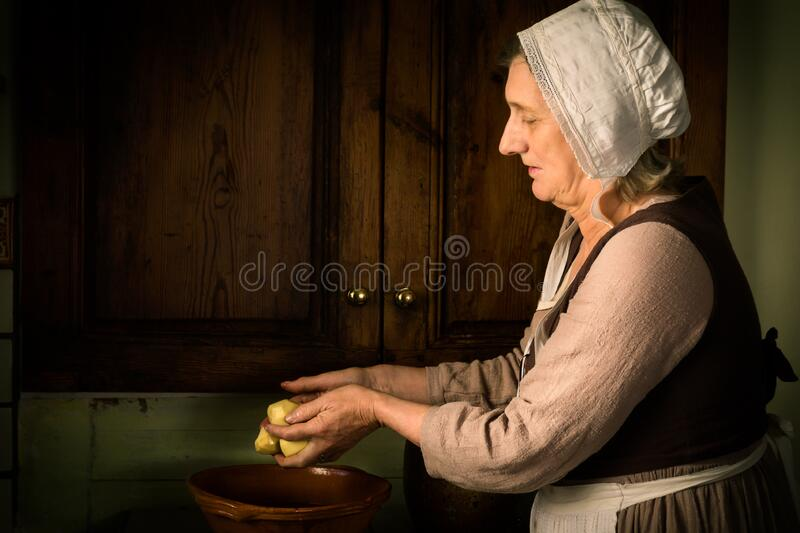 Old Master portrait woman in kitchen stock image