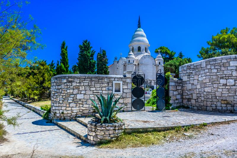 Old mausoleum in Supetar town, Island Brac. Scenic view at old stone mausoleum in Brac island, croatian traditional culture stock photos