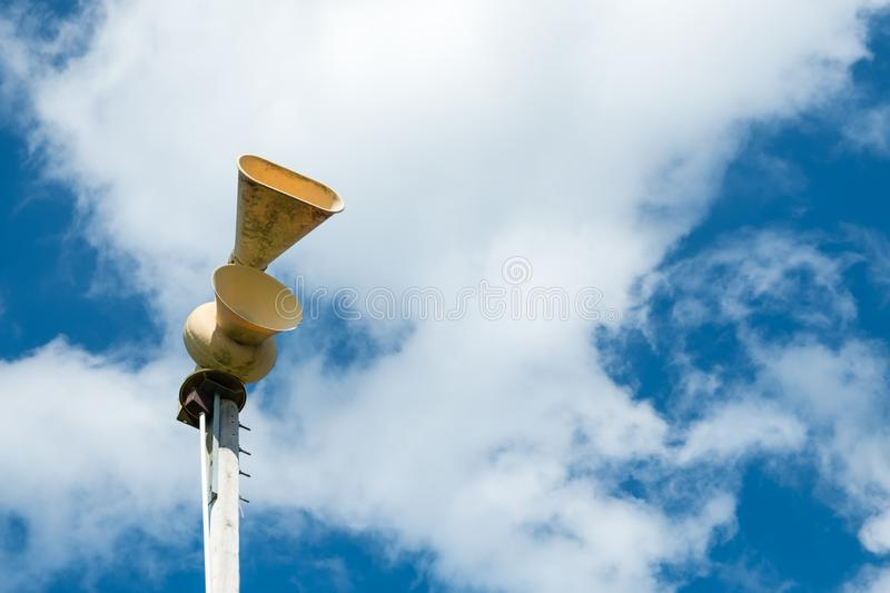 Old mechanical civil defense siren, also known as air-raid siren. Or tornado siren royalty free stock images