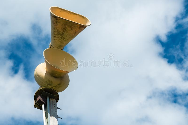 Old mechanical civil defense siren, also known as air-raid siren. Or tornado siren stock image