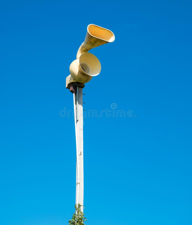 Old mechanical civil defense siren, also known as air-raid siren. Or tornado siren royalty free stock photos