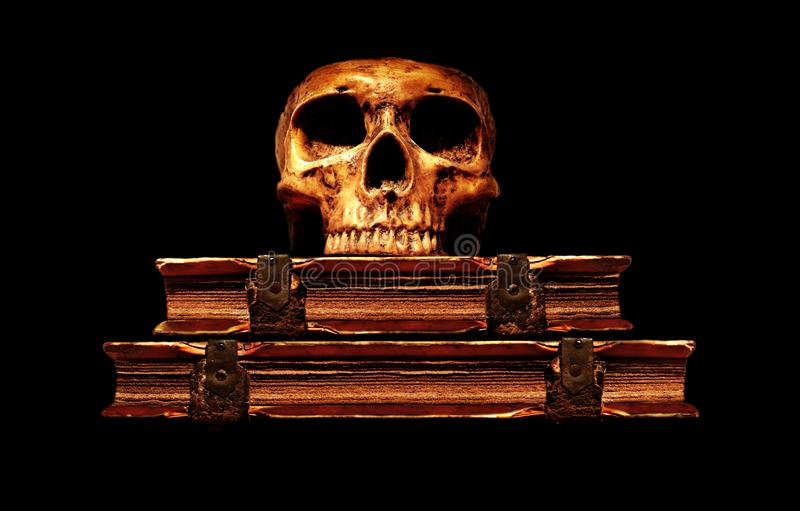 Old medical skull lay down to the old leather bound books royalty free stock image