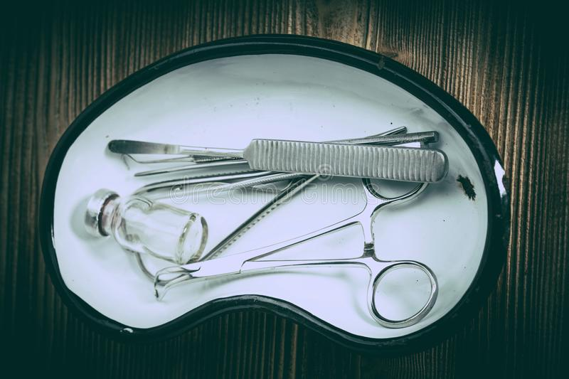 Old medicine equipment on wooden background. royalty free stock images