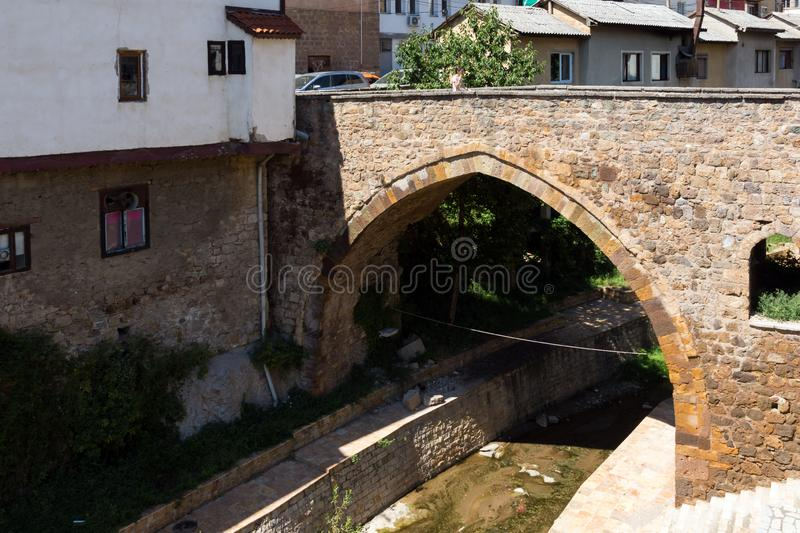 Old Medieval Bridge at the center of town of Kratovo, Republic of Macedonia. KRATOVO, MACEDONIA - JULY 21, 2018: Old Medieval Bridge at the center of town of stock images