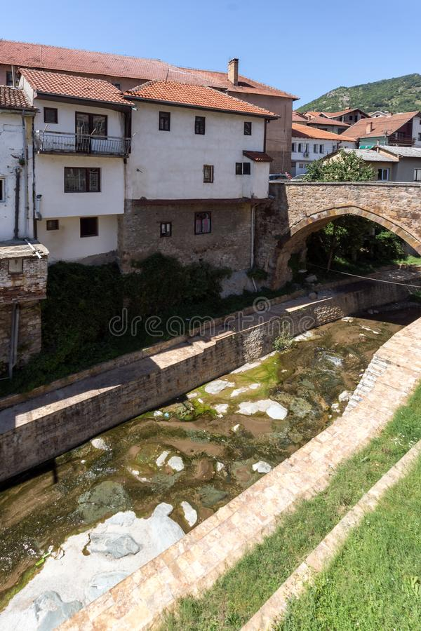 Old Medieval Bridge at the center of town of Kratovo, Republic of Macedonia. KRATOVO, MACEDONIA - JULY 21, 2018: Old Medieval Bridge at the center of town of royalty free stock photos