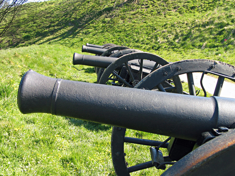 Old Medieval cannons. Old Medieval cannon by the city walls of Fredericia Denmark stock images