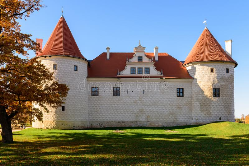Old medieval castle with orange tree near it in Bauska town, Latvia. ÑŽ stock images