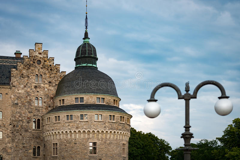 Old medieval castle in Orebro, Sweden, Scandinavia. Europe. Landmark in foreground and blue cloudy sky in background. Architecture and travel stock images